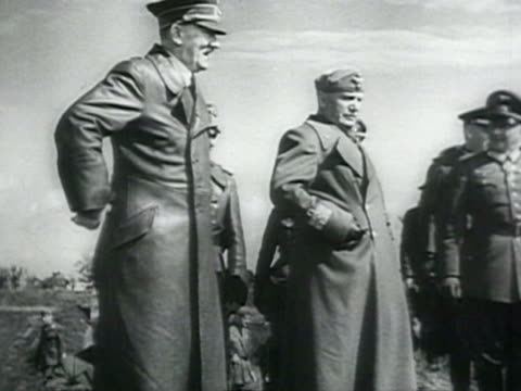 MS Adolf Hitler and Benito Mussolini inspecting destroyed Soviet armaments fighting equipment flower in ruins empty cartridges helmet in BrestLitovsk...