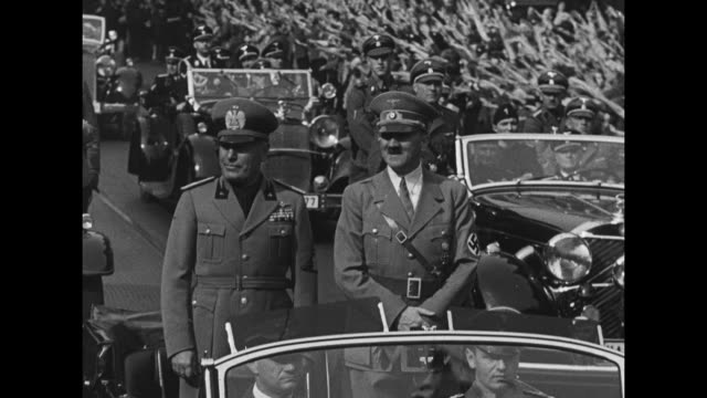 adolf hitler and benito mussolini standing up in open car ride down the street followed by other cars, crowds line street cheer and give nazi salute - benito mussolini stock videos & royalty-free footage