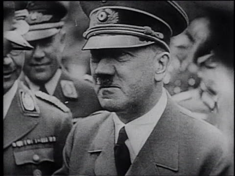 vídeos de stock, filmes e b-roll de adolf hitler and hermann goering meeting with nazi officers / graphic of the german army advancing across europe - adolf hitler