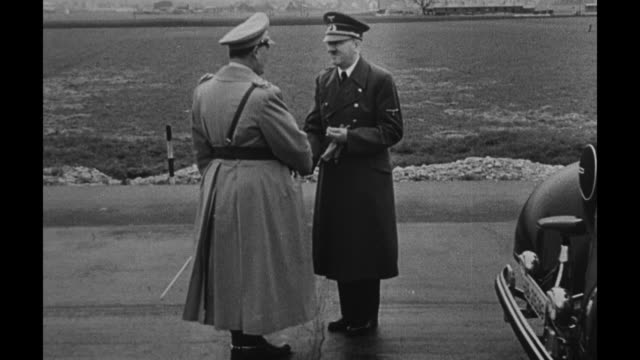 adolf hitler and hermann goering saluting; they shake hands and chat at an airport tarmac and weapons are displayed; the men inside a railroad car /... - adolf hitler stock videos & royalty-free footage