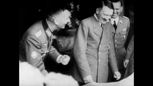 / adolf hitler and his officers consulting a map / japanese officers consulting a map / adolf hitler laughing with his men. germany and japan working... - 1944 stock videos & royalty-free footage