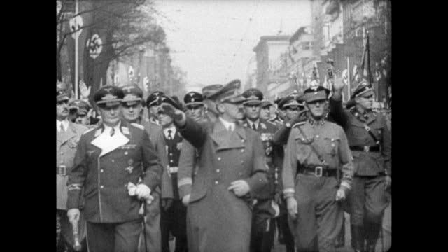 / adolf hitler and nazis march through streets in the sudetenland, czechoslovakia after the annexation of the territory into the german reich / crowd... - 1938 stock videos & royalty-free footage
