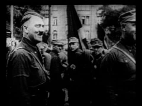 adolf hitler approaches with guards on both sides as he walks down aisle at event crowd on both sides gives nazi salute / hitler gives nazi salute as... - nazi swastika stock videos & royalty-free footage