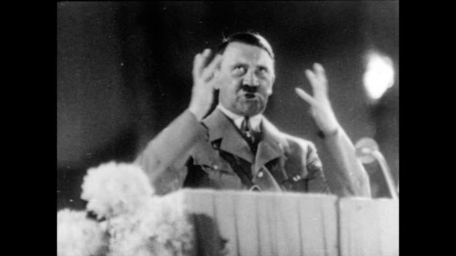 vídeos de stock, filmes e b-roll de / adolf hitler gives passionate speech from podium / hermann goering sits arms folded listening . adolf hitler giving passionate speech on january... - adolf hitler