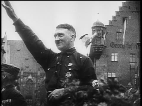 adolf hitler giving fascist salute at nuremberg rally / newsreel - adolf hitler stock-videos und b-roll-filmmaterial