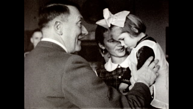 adolf hitler greets various women of his domestic staff / woman carrying a young girl wearing bow in her hair, approaches hitler / hitler shake hands... - adolf hitler stock videos & royalty-free footage