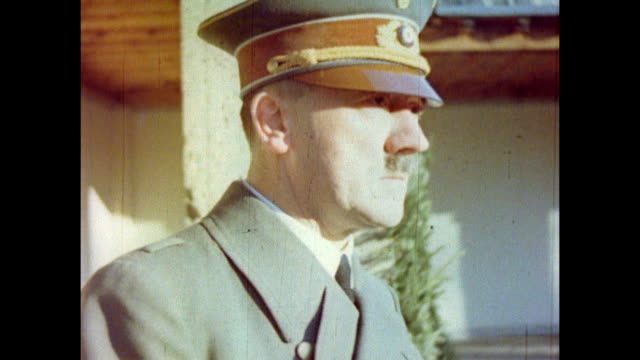 vídeos de stock, filmes e b-roll de adolf hitler in a military overcoat as he stands on the berghof terrace. adolf hitler at berchtesgaden, germany, 1940 - adolf hitler