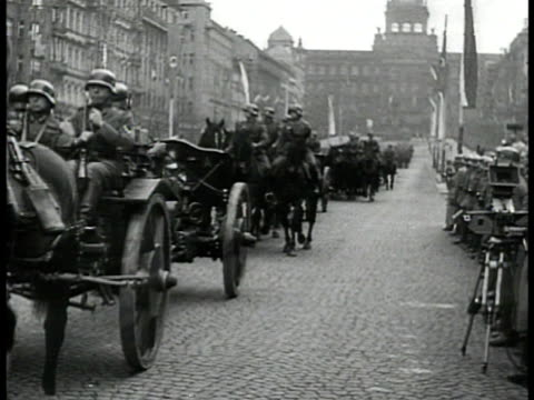 adolf hitler riding car down prague street la ws swastika flag on top of building ms german troops parading ms officials standing ws tanks down... - prague stock videos & royalty-free footage