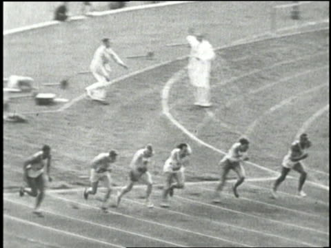 stockvideo's en b-roll-footage met adolf hitler salutes at the opening ceremonies for the 1936 berlin olympic summer games where united states athlete jesse owens dominates the track... - 1936