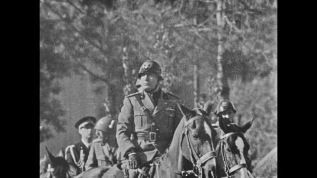 stockvideo's en b-roll-footage met adolf hitler sitting next to goering benito mussolini sitting on horseback boy king peter of yugoslavia walking w/ generals czechoslovakian edvard... - benito mussolini