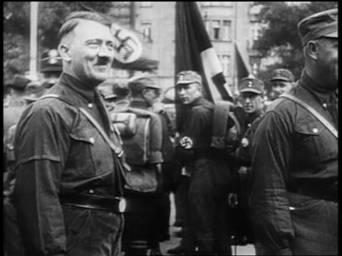 adolf hitler smiling heiling at nuremberg rally / newsreel - adolf hitler stock-videos und b-roll-filmmaterial