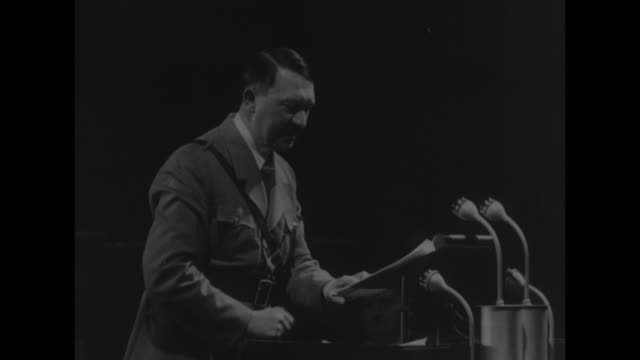 adolf hitler speaking at podium expressively using gestures during speech in nuremberg probably in september 1938 at the nuremberg rally / note exact... - 1938 stock-videos und b-roll-filmmaterial