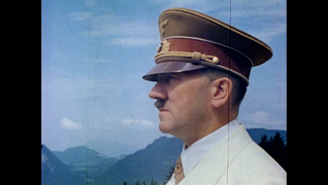 vídeos de stock, filmes e b-roll de adolf hitler speaks with chief adjutant, wilhelm bruckner on berghof terrace / hitler does a brief happy dance / hitler speaking with politician... - adolf hitler