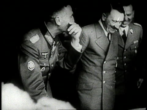 vidéos et rushes de adolf hitler standing at conference table with military advisers all smiling / germany - wehrmacht