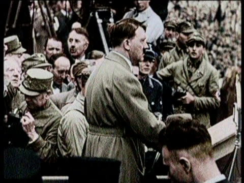 vídeos de stock, filmes e b-roll de / adolf hitler takes his own life on april 30, 1945 / footage of hitler's life and war / nazi emblem and flag / soldiers marching through street with... - adolf hitler