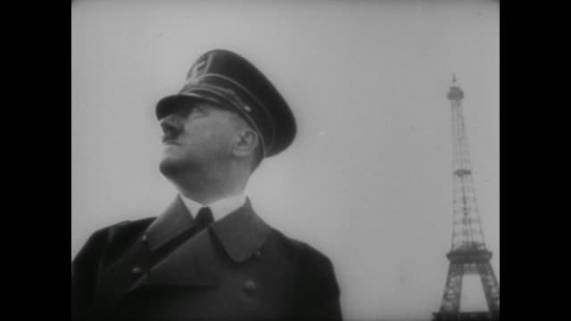 vídeos de stock, filmes e b-roll de adolf hitler travels through the ruined city of dunkirk before arriving at the devastated port of calais. - adolf hitler