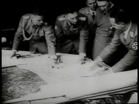 adolf hitler w/ german officials standing over map on table. hitler laughing w/ officials. germany. wwii. world war ii. nazi. - 1941 stock-videos und b-roll-filmmaterial