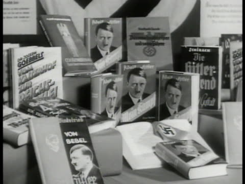 adolf hitler's 'mein kampf' books on display. hitler photograph on book cover. nazi wwii - book cover stock videos & royalty-free footage