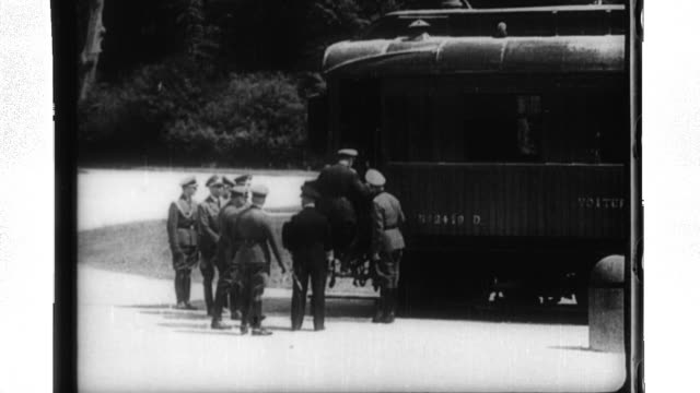adolph hitler and senior nazi officers meet with french officials to accept the french surrender in a rail car in the forest of compiegne. - adolf hitler stock-videos und b-roll-filmmaterial