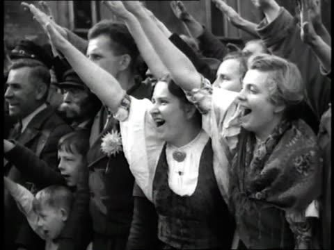 adolph hitler leads a parade through a european town. - tschechische republik stock-videos und b-roll-filmmaterial