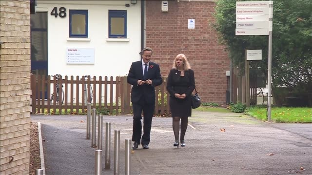 David Cameron visits Coram children's charity ENGLAND London Coram children's charity EXT David Cameron MP along with unidentified woman and arriving...