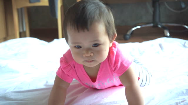adorable asian baby crawl