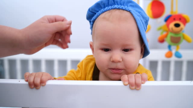 adorable baby boy in the crib - cap stock videos & royalty-free footage