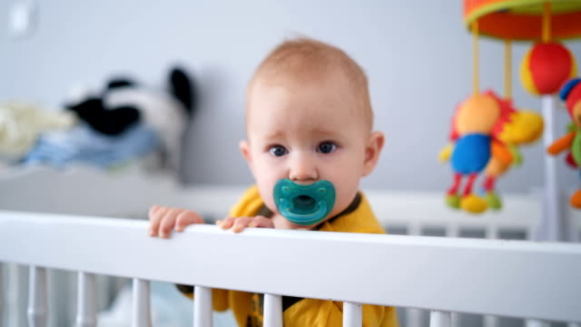adorable baby boy in the crib - pacifier stock videos and b-roll footage