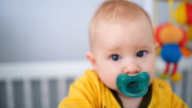 adorable baby boy in the crib - cot stock videos & royalty-free footage
