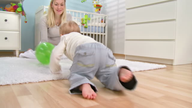 hd: adorable baby crawling to mum - crawling stock videos & royalty-free footage