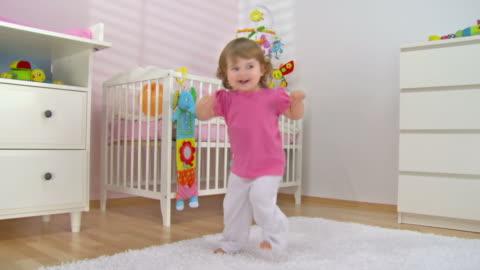 hd crane: adorable baby girl dancing - toddler stock videos & royalty-free footage