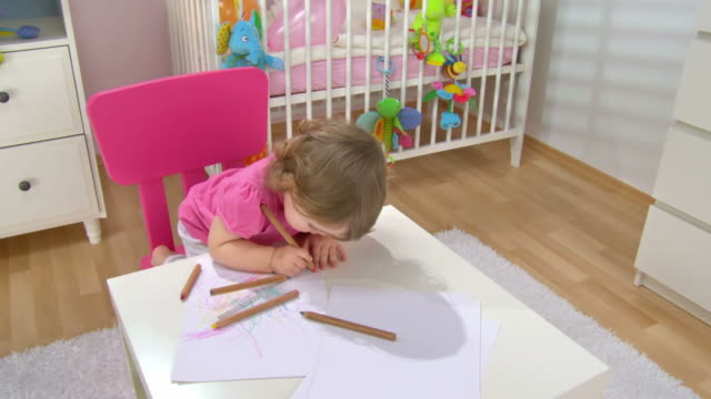 hd crane: adorable baby girl drawing - crayon stock videos and b-roll footage