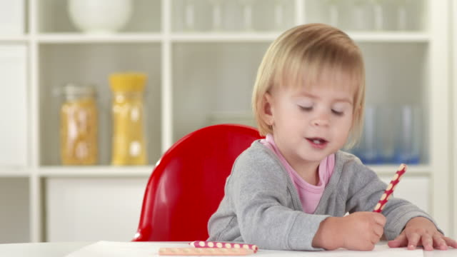 hd: adorable baby having fun while drawing - crayon stock videos and b-roll footage