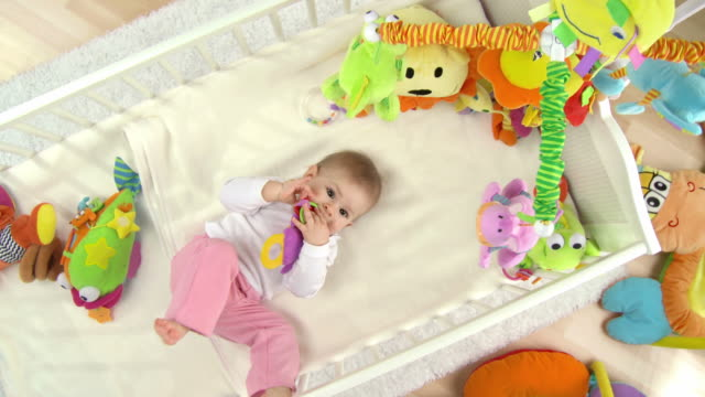 hd crane: adorable baby lying in crib - cot stock videos & royalty-free footage