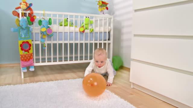 hd dolly: adorable baby playing with the balloon - babies only stock videos & royalty-free footage
