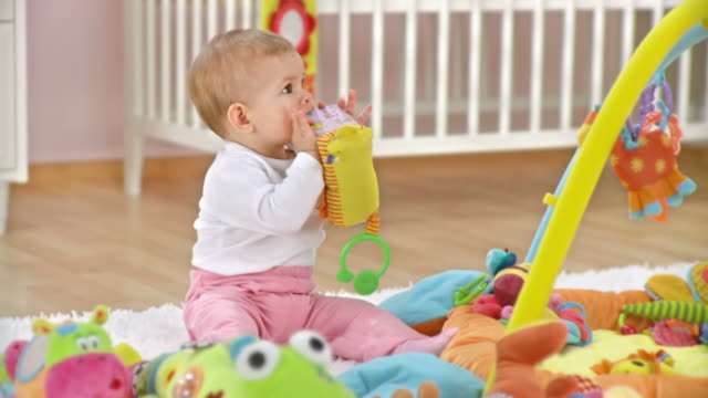 hd dolly: adorable baby playing with toys - one baby girl only stock videos & royalty-free footage