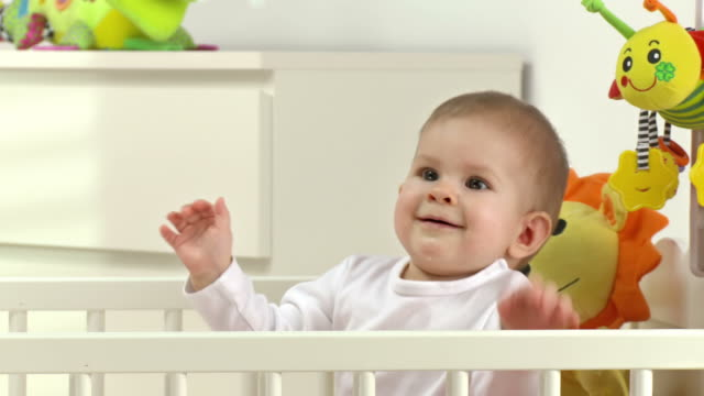 hd dolly: adorable baby sitting in crib - one baby girl only stock videos & royalty-free footage