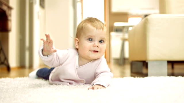 adorable baby waving with a hand - one baby girl only stock videos & royalty-free footage