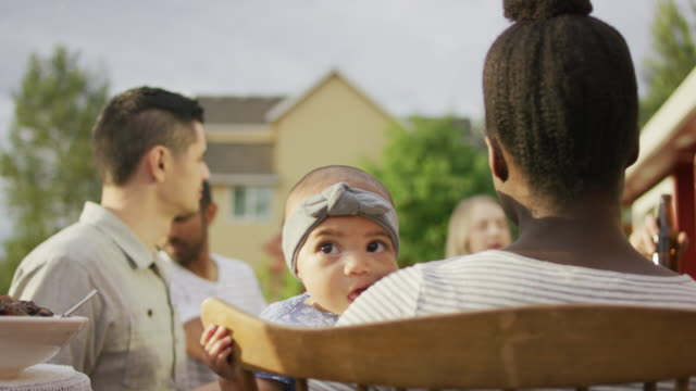 adorable biracial baby at an outdoor dinner party - pacific islander couple stock videos & royalty-free footage