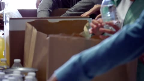 adorable children volunteer with family during community food drive - volunteer stock videos & royalty-free footage