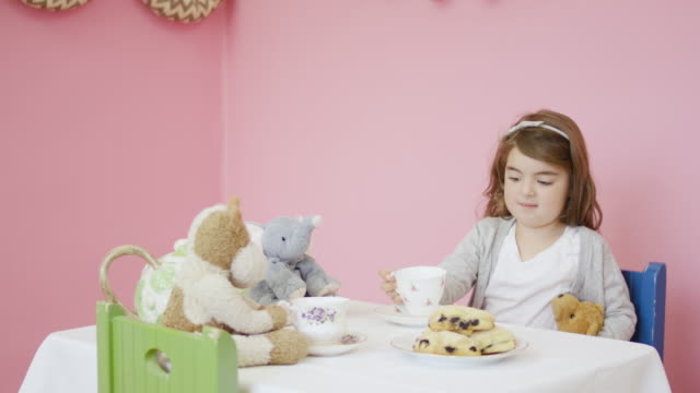 adorable girl having a tea party with her stuffed animals - tea party stock videos and b-roll footage