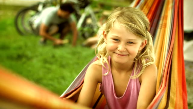 adorable girl in the hammock - camping stock videos & royalty-free footage