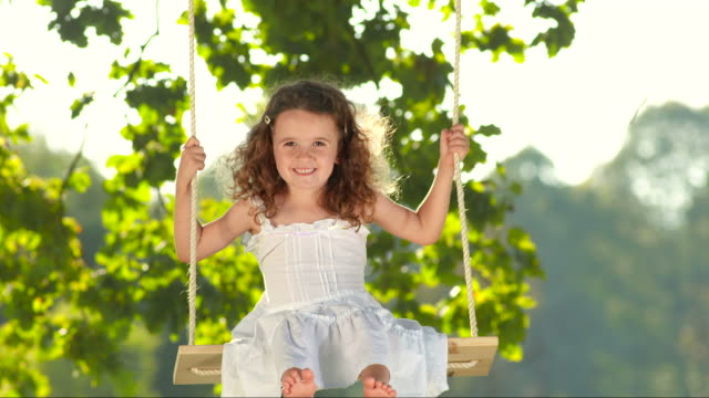 hd slow motion: adorable girl on a tree swing - preschool student stock videos and b-roll footage