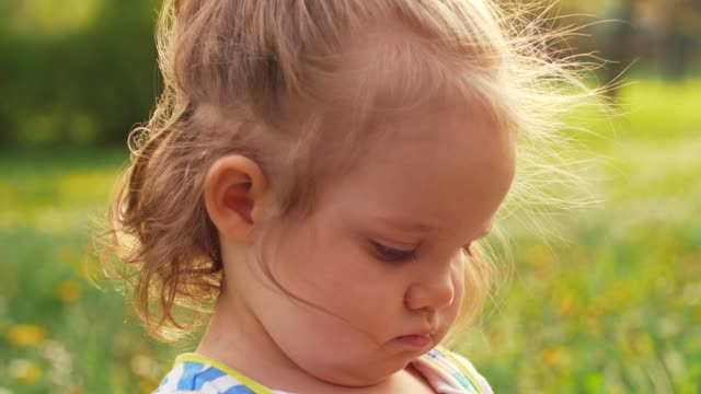 adorable girl playing on a meadow - one baby girl only stock videos & royalty-free footage