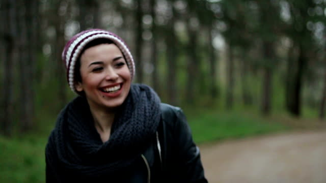 Adorable girl with an wide open smile walking in a park