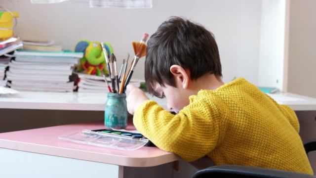 adorable little boy, drawing picture - disegnare video stock e b–roll
