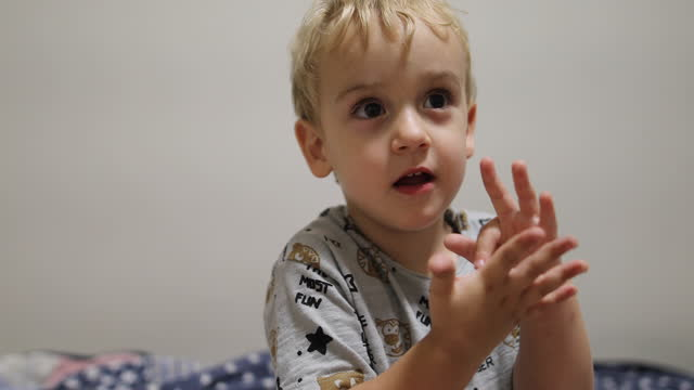adorable little boy in the bedroom - baby boys stock videos & royalty-free footage