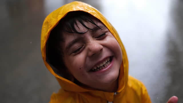 adorable little boy playing at rainy day - yellow stock videos & royalty-free footage