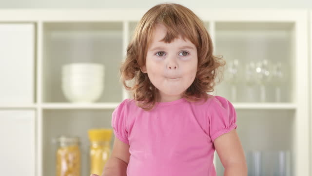 hd: adorable little girl blushing - grimacing stock videos & royalty-free footage