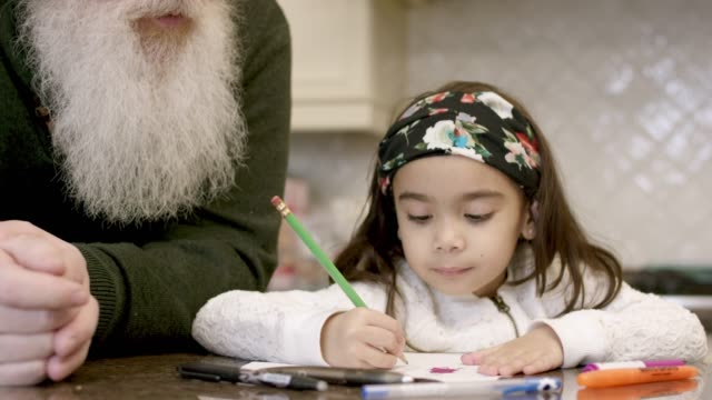 adorable little girl colours with her grandpa - fat camera stock videos and b-roll footage